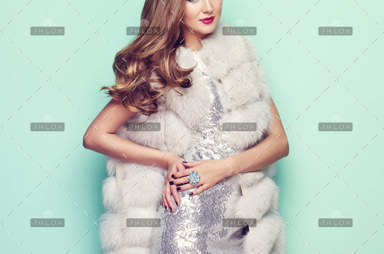 demo-attachment-77-fashion-portrait-young-woman-in-white-fur-coat-PZ74KRU