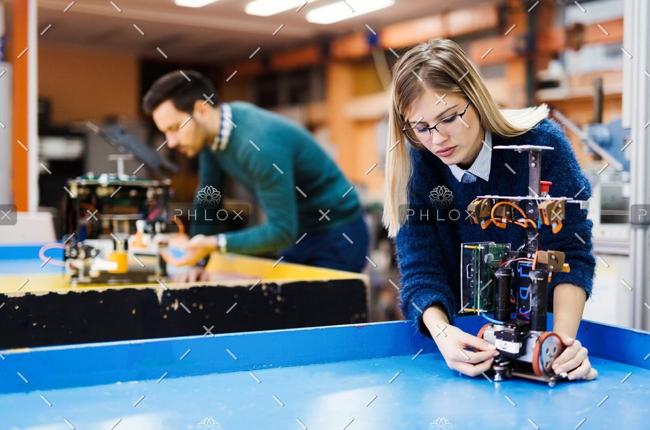 demo-attachment-116-young-student-of-robotics-working-on-project-S32GWUC