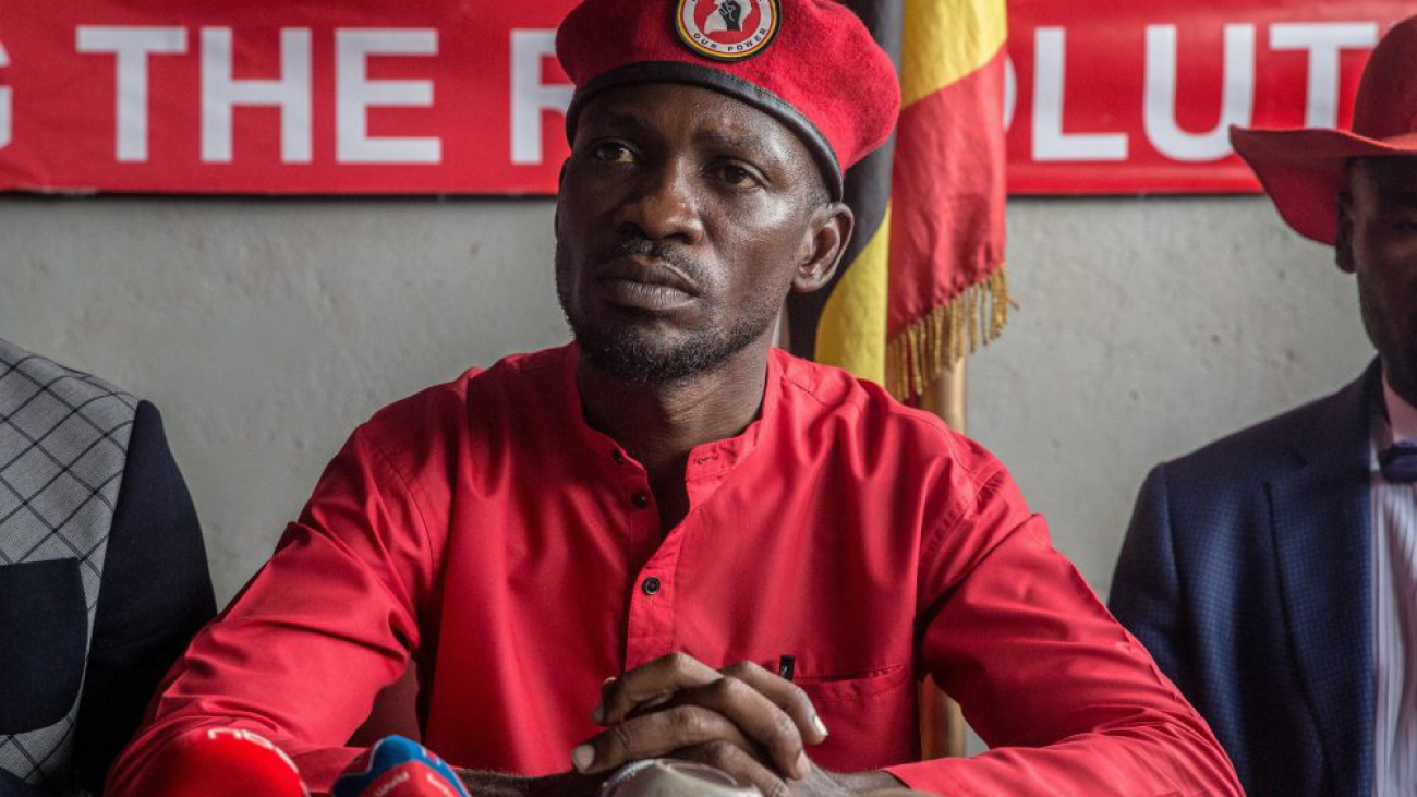 """Musician and opposition candidate Bobi Wine holds a press conference, encouraging his """"people power"""" supporters to continue wearing their trademark red berets in Kampala after the military banned them."""