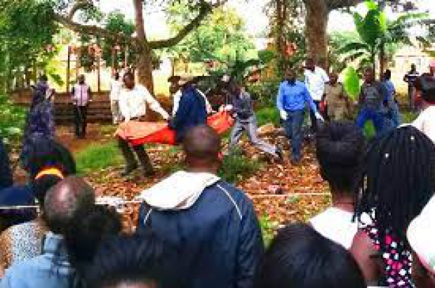 Residents carrying the body of woman murders in previous entebbe murders